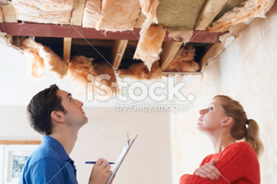 stock-photo-22519026-builder-and-client-inspecting-roof-damage